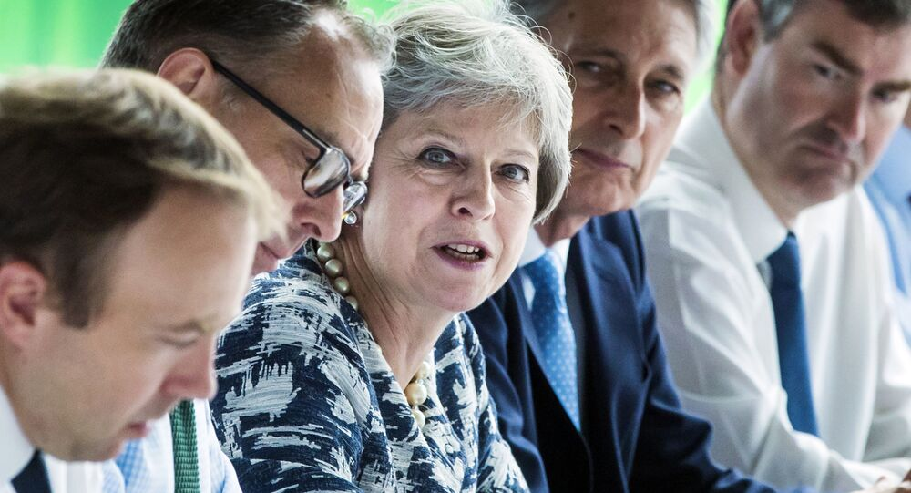 Britain's Prime Minister Theresa May (C) chairs a meeting of her Cabinet at Sage Gateshead, in Gateshead, north-east England on July 23, 2018.
