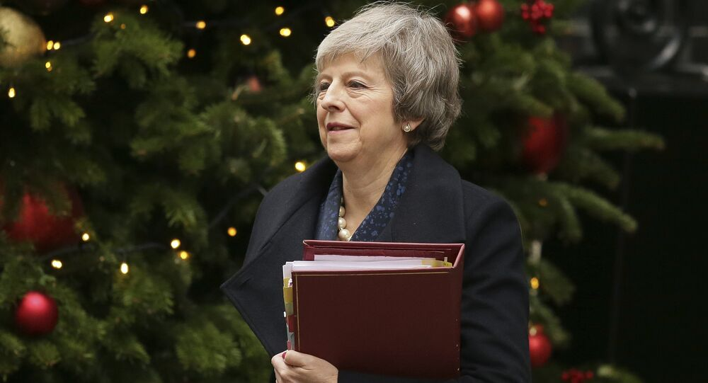 Britain's Prime Minister Theresa May leaves 10 Downing Street to attend the weekly Prime Ministers' Questions session, at parliament in London, Wednesday, Dec. 12, 2018. May has confirmed there will be a vote of confidence in her leadership of the Conservative Party, in Parliament Wednesday evening, with the result expected to be announced soon after.