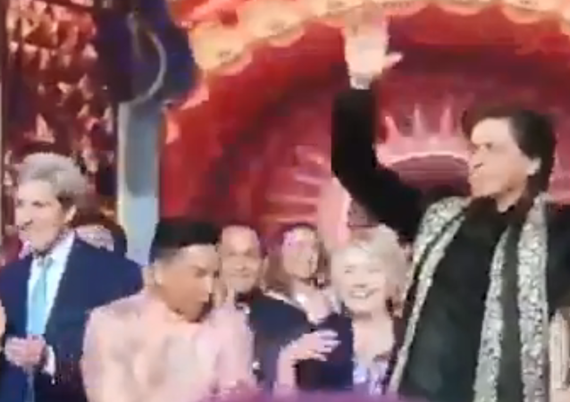 John Kerry and Hillary Clinton are spotted dancing with Shah Rukh Khan at Isha Ambani's pre-wedding bash in Udaipur