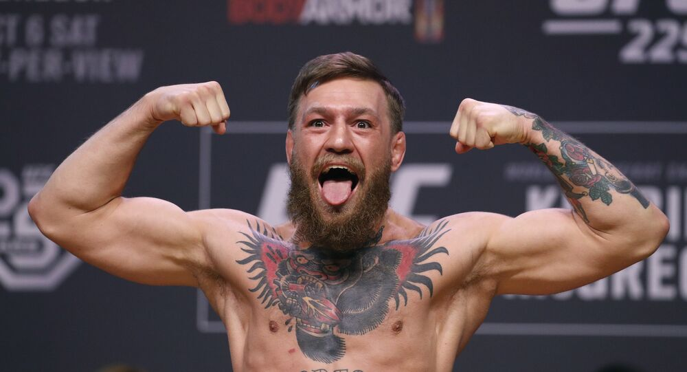 Conor McGregor poses during a ceremonial weigh-in for the UFC 229 mixed martial arts fight Friday, Oct. 5, 2018, in Las Vegas.