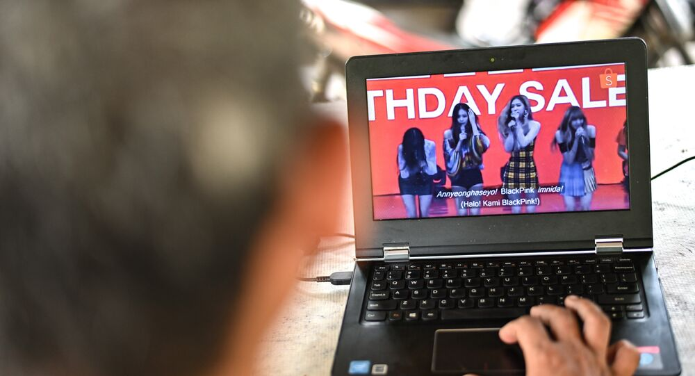 A man watches a commercial featuring K-pop supergroup Blackpink on his laptop in Jakarta on December 12, 2018, after the advertisement was banned by the Indonesian Broadcasting Commission.