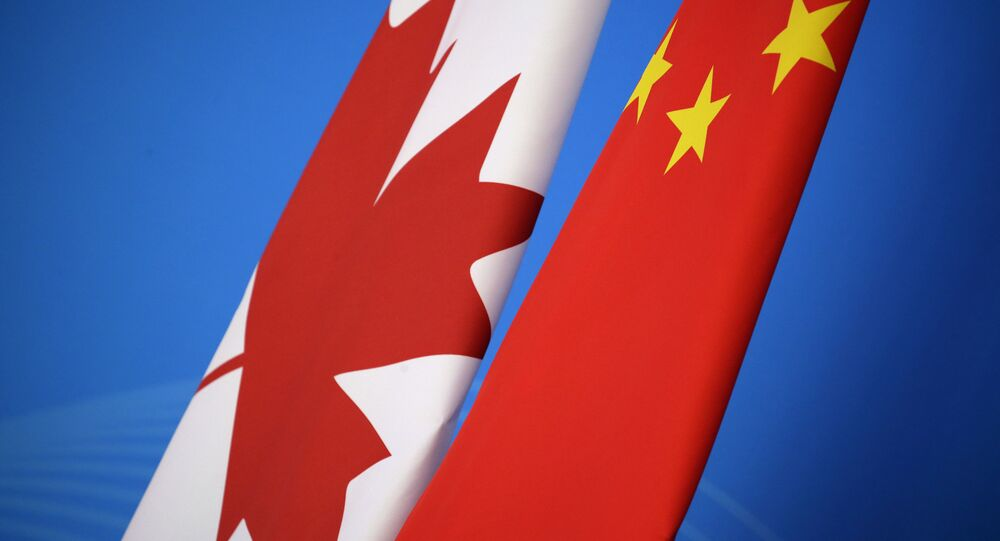 Flags of Canada and China are placed for the first China-Canada economic and financial strategy dialogue in Beijing, China, Monday, Nov. 12, 2018