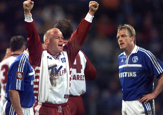 Danish Stig Toefting from Hamburg, center, celebrating Hamburg's 1-0 victory in the German first division soccer match