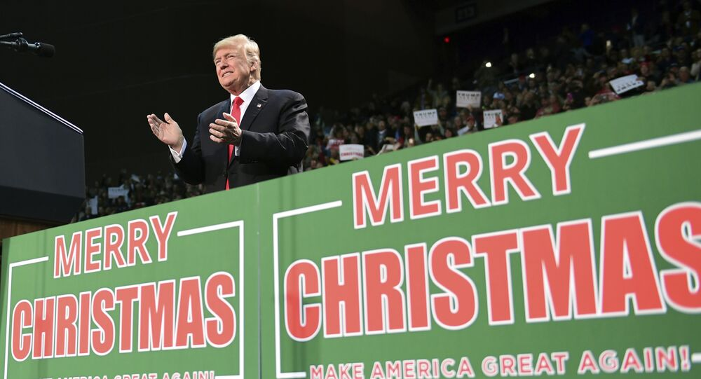 In this Dec. 8, 2017, file photo, President Donald Trump takes to the stage at a campaign-style rally at the Pensacola Bay Center, in Pensacola, Fla. (File photo)