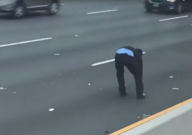 A Brinks Security Guard Chases Loose Money from Armored Car on New Jersey Highway