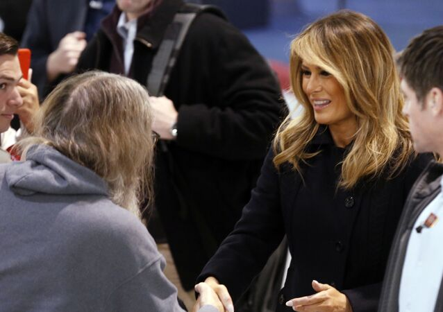 First Lady Melania Trump, right, greets members of the crowd during a tour of Joint Base Langley in Hampton, Va., Wednesday, Dec. 12, 2018.