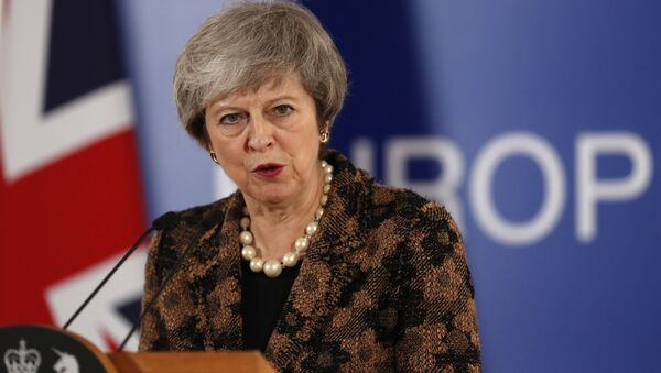 British Prime Minister Theresa May speaks during a media conference during an EU summit in Brussels, Friday, Dec. 14, 2018. - Sputnik International