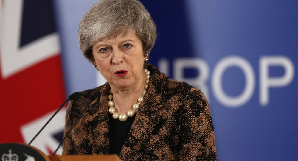 British Prime Minister Theresa May speaks during a media conference during an EU summit in Brussels, Friday, Dec. 14, 2018.