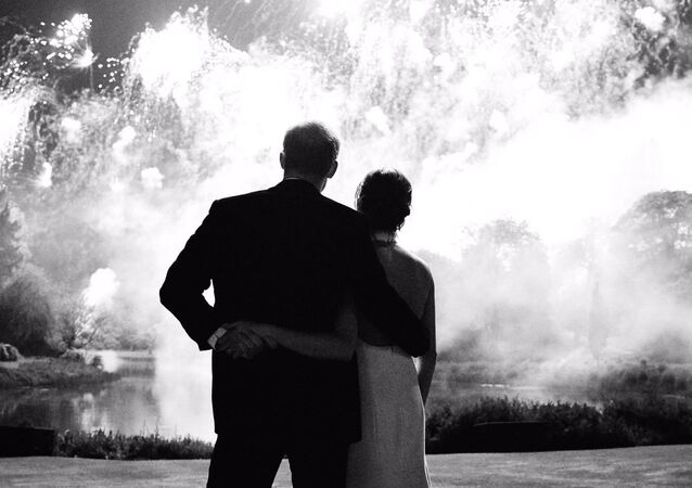 The photograph, which features on Their Royal Highnesses' Christmas card, was taken by photographer Chris Allerton