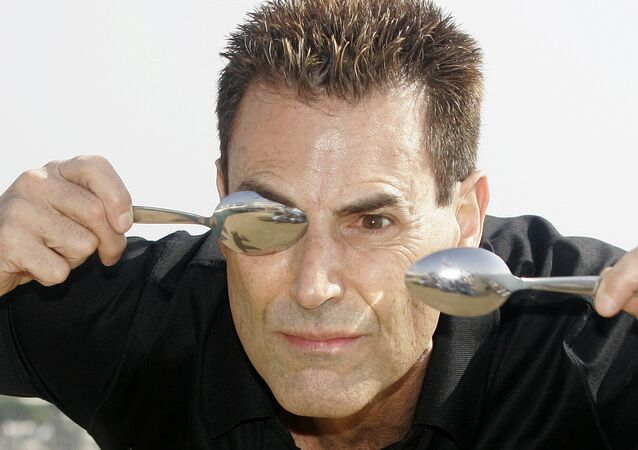 Israeli-British illusionist Uri Geller poses during the 24th MIPCOM (International Film and Programme Market for Tv, Video,Cable and Satellitte) in Cannes, southeastern France, Tuesday, Oct 14, 2008.