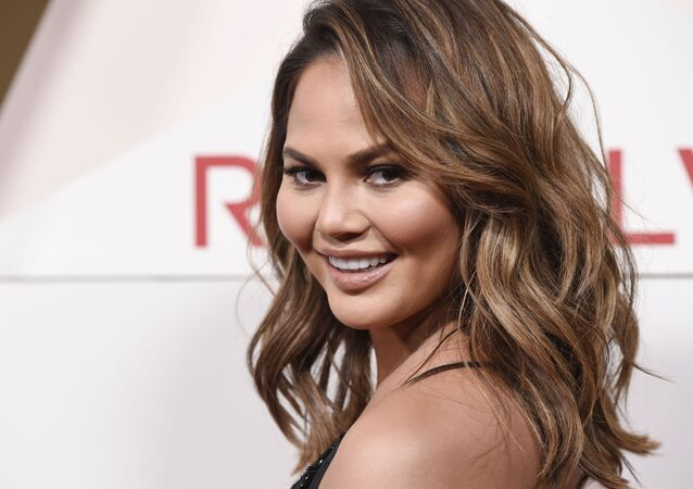 FILE - In this 2 November 2017 file photo, model Chrissy Teigen poses at the 2017 Revolve Awards at the Dream Hollywood hotel in Los Angeles.