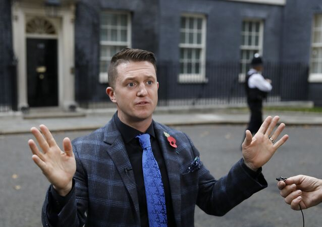 Founder and former leader of the anti-Islam English Defence League, Stephen Yaxley-Lennon, AKA Tommy Robinson, talks to the media after delivering a petition to 10 Downing Street in central London on November 6, 2018.