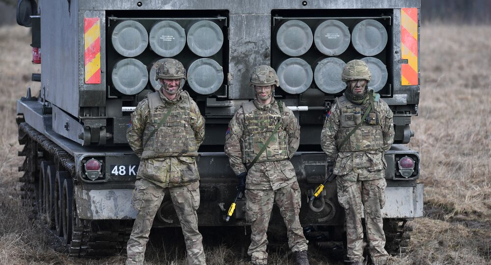 British artillery soldiers are pictured after a shooting session during the 'Dynamic Front 18' exercise in Grafenwoehr, near Eschenbach, southern Germany, on March 7, 2018.
