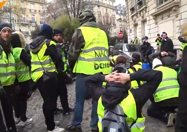 Yellow Vests hold protests in Paris, France, on 15 December, 2018