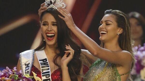 Catriona Gray of the Philippines, left, reacts as she is crowned the new Miss Universe 2018 by Miss Universe 2017 Demi-Leigh Nel-Peters during the final round of the 67th Miss Universe competition in Bangkok, Thailand, Monday, Dec. 17, 2018. - Sputnik International