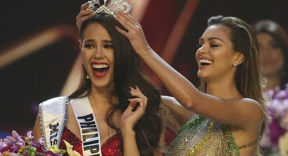 Catriona Gray of the Philippines, left, reacts as she is crowned the new Miss Universe 2018 by Miss Universe 2017 Demi-Leigh Nel-Peters during the final round of the 67th Miss Universe competition in Bangkok, Thailand, Monday, Dec. 17, 2018.