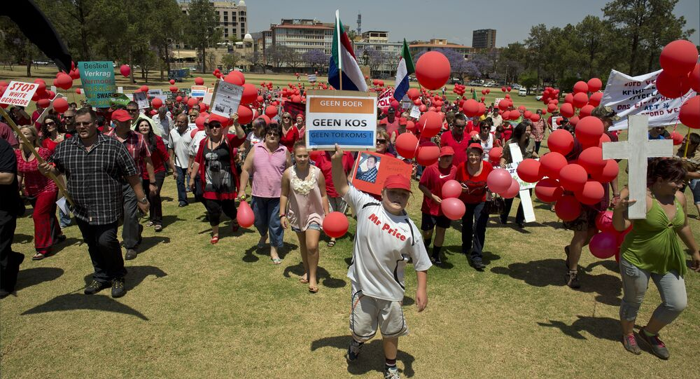 Some of the 400 White South Africans, holding placards reading No Farmer, No Food, No Future, march to protest the violent murder of farmers, which they term 'genocide', and 'oppressive' state policies in favour of Blacks in Pretoria on October 10, 2013
