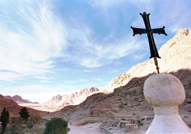 In this Wednesday, Jan. 7, 1998 file photo, the shadow of Mount Sinai stretches across the valley at the foot of the Greek Orthodox Monastery of St. Catherine in the Sinai peninsula some 240 miles southeast of Cairo, Egypt