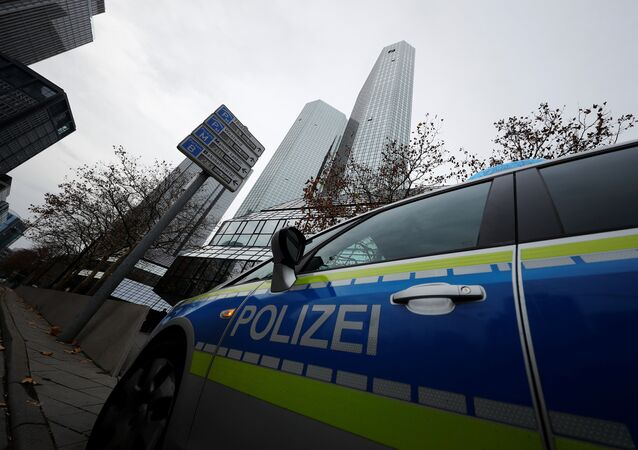 Police vehicles are parked in front of Deutsche Bank headquarters as roughly 170 criminal police officers, prosecutors and tax inspectors searched Deutsche Bank offices in and around Frankfurt, Germany, November 29, 2018