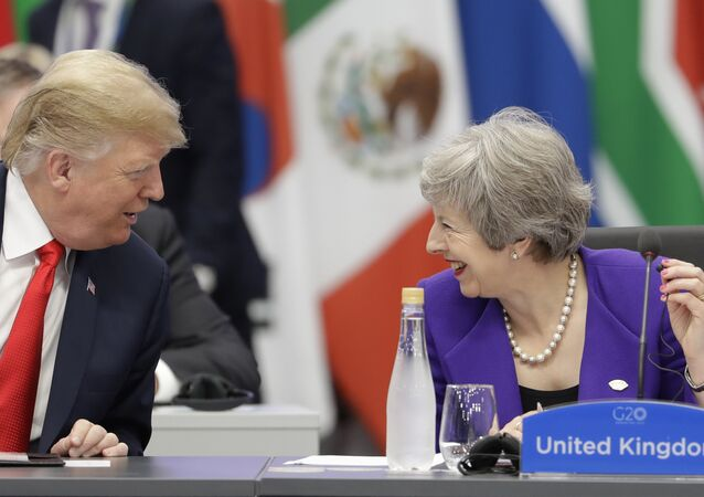 Britain's Prime Minister Theresa May, right, speaks with President Donald Trump during the G20 summit in Buenos Aires, Argentina, Friday, Nov. 30, 2018