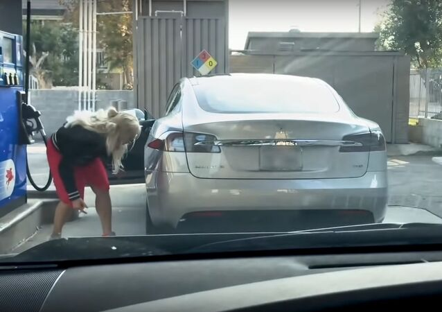 Blonde, Tesla and Gas Station?
