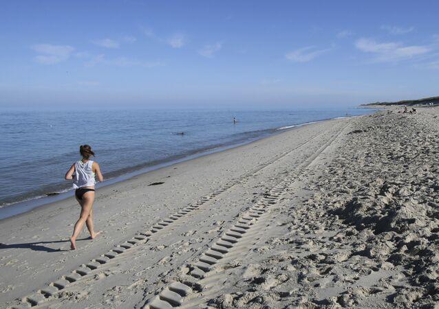 A woman running on a beach