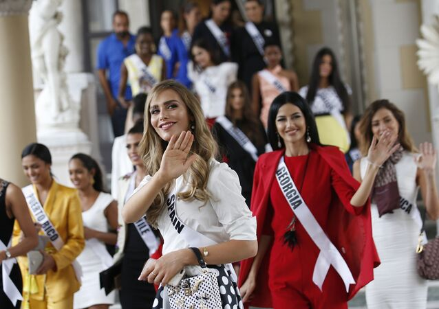 Miss Spain Angela Ponce, center, the first transgender woman to take part in the Miss Universe contest and with Miss Universe 2018 contestants visit the Government House in Bangkok, Thailand Tuesday, Dec. 11, 2018.