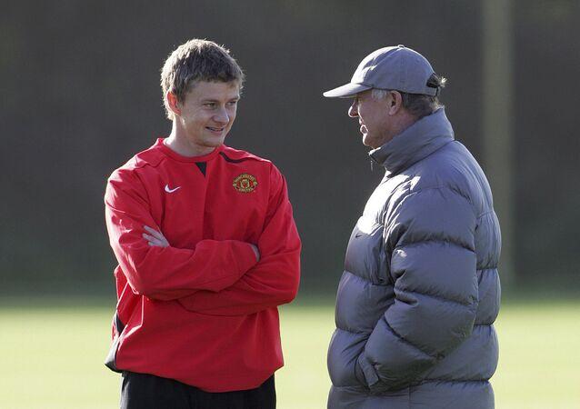 Ole Gunnar Solskjaer, pictured with his former boss Sir Alex Ferguson