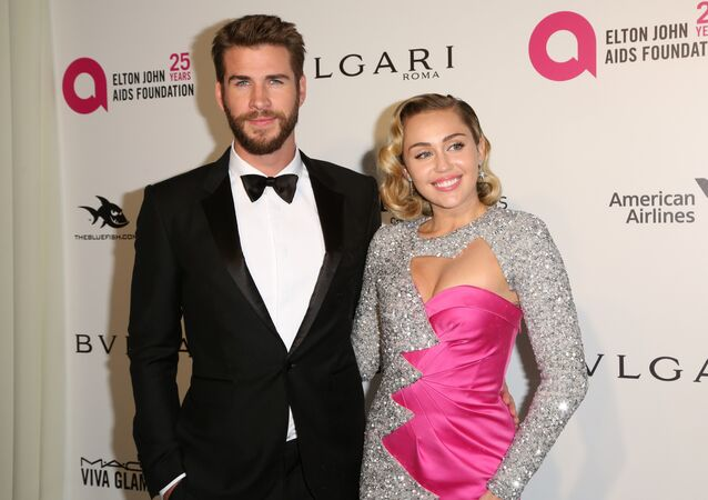 Liam Hemsworth, left, and Miley Cyrus arrive at the 2018 Elton John AIDS Foundation Oscar Viewing Party on Sunday, March 4, 2018, in West Hollywood, Calif.