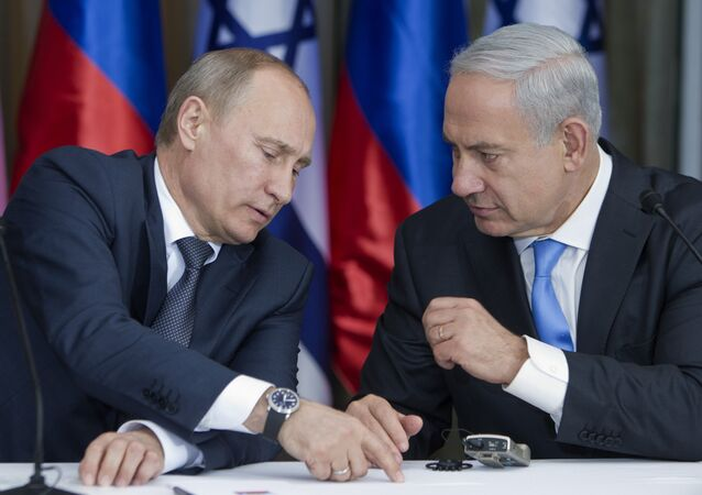 Russian President Vladimir Putin, left, speaks with Israeli Prime Minister Benjamin Netanyahu as they prepare to deliver joint statements after their meeting and a lunch in the Israeli leader's Jerusalem residence, June 25, 2012