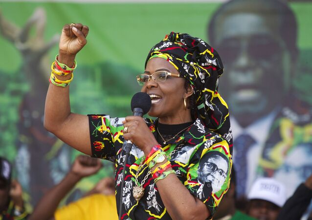 Zimbabwean President Robert Mugabe's wife Grace greets party supporters at a rally in Chinhoyi about 120 Kilometres west of the capital Harare, Saturday, July, 29, 2017