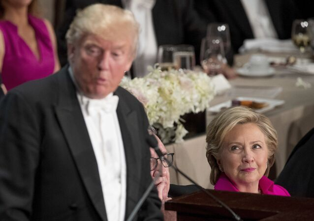 Republican presidential candidate Donald Trump, left, accompanied by Democratic presidential candidate Hillary Clinton, right, speaks at the 71st annual Alfred E. Smith Memorial Foundation Dinner, a charity gala organized by the Archdiocese of New York, Thursday, Oct. 20, 2016, at the Waldorf Astoria hotel in New York