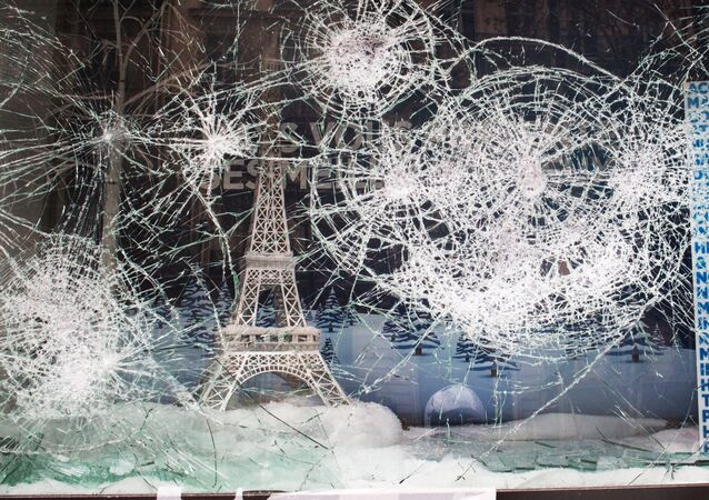 An Eiffel Tower is seen at a store front window vandalized by the yellow vests movement, in Paris, France. Rising protests that first began on November 17 and erupted over high living costs has morphed into a broader anti-government rebellion.