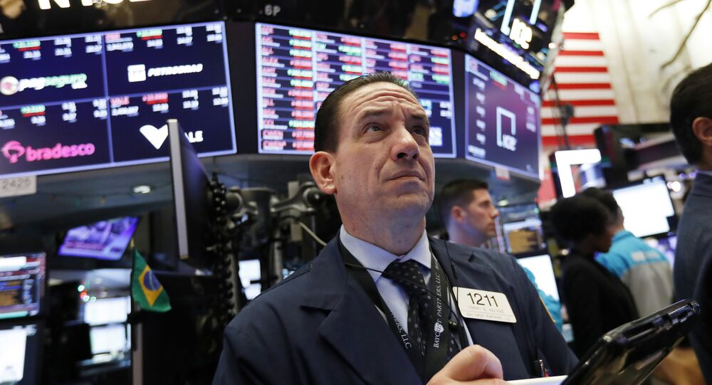 In this 6 December 2018 file photo, trader Tommy Kalikas works on the floor of the New York Stock Exchange.