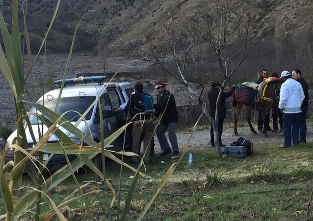 In this photo provided by Moroccan news channel 2M and taken on Tuesday, Dec. 18, 2018, a security team is seen at the area where the bodies of two Scandinavian women tourists were found dead, near Imlil in the High Atlas mountains, Morocco