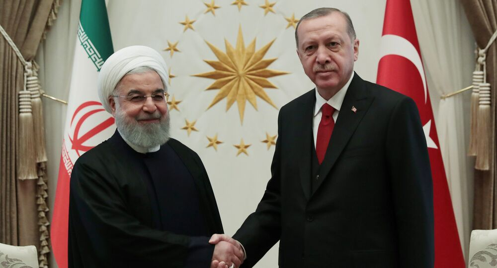 Turkish President Tayyip Erdogan shakes hands with his Iranian counterpart Hassan Rouhani before a meeting at the Presidential Palace in Ankara, Turkey, December 20, 2018