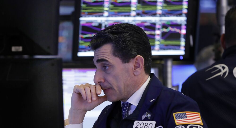 In this Dec. 6, 2018, file photo, specialist Peter Mazza works at his post on the floor of the New York Stock Exchange.