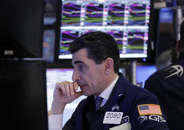 In this Dec. 6, 2018, specialist Peter Mazza works at his post on the floor of the New York Stock Exchange.