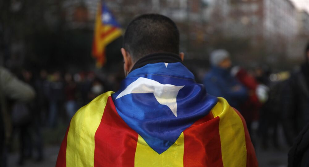 A pro-independence demonstrator stands in downtown Barcelona, Spain, Friday Dec. 21, 2018