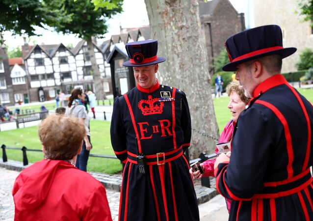 Yeoman Warders interact with tourists at the Tower of London in London, Britain, July 20, 2017