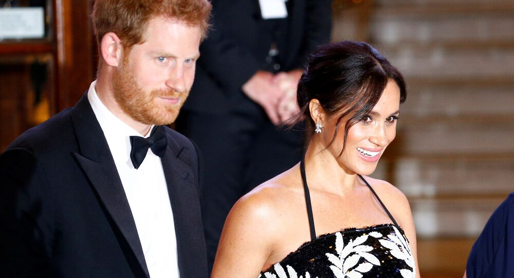 FILE PHOTO: Britain's Prince Harry and Meghan, the Duchess of Sussex, leave after the Royal Variety Performance in London, Britain November 19, 2018