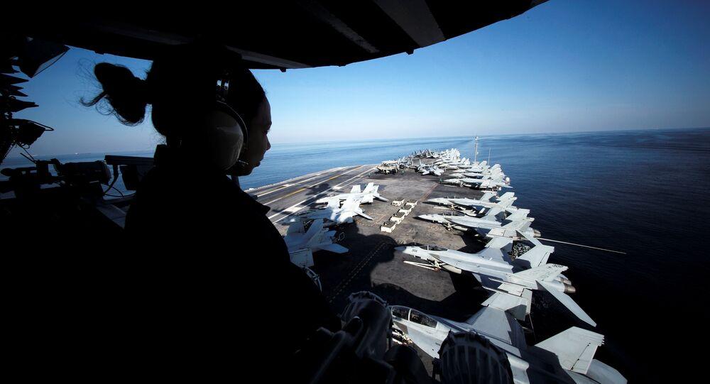 USS John C. Stennis makes its way to the Persian Gulf through the Strait of Hormuz