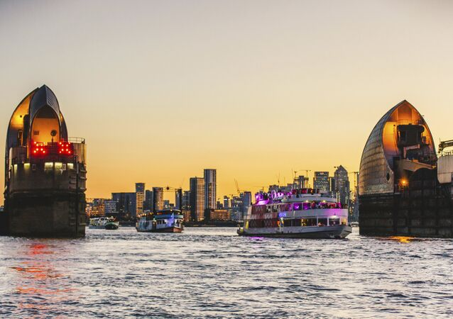 The boats travel through the Thames Barrier at sunset as the river plays host to an epic voyage through British music culture at Red Bull Music Odyssey in London, England