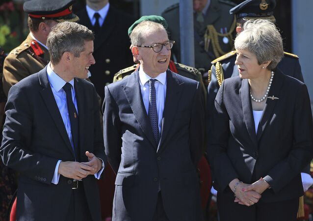 Secretary of State for Defence, Gavin Williamson, left, and Prime Minister Theresa May with her husband Philip, centre, during celebrations marking National Armed Forces Day in Llandudno, Wales, Saturday June 30, 2018.