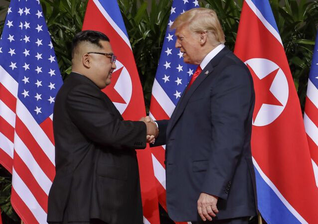 US President Donald Trump shakes hands with North Korea leader Kim Jong Un at the Capella resort on Sentosa Island Tuesday, June 12, 2018 in Singapore.