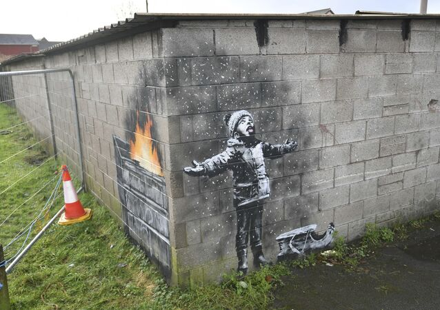 Artwork by street artist Banksy, Thursday Dec. 20, 2018, which appeared on a garage wall in Taibach, Port Talbot, south Wales. Street artist and social commentator Banksy has apparently popped up in Wales, leaving a new artwork on a garage in Port Talbot that references the town's air pollution.