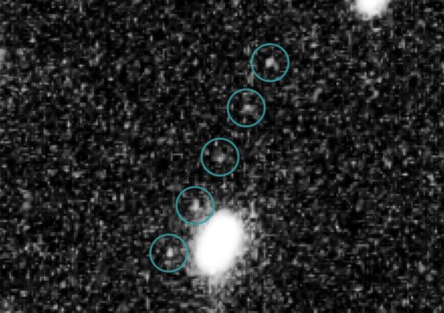 discovery images of Kuiper Belt object 2014 MU69 (Ultima Thule) taken on June 24, 2014, by the Hubble telescope