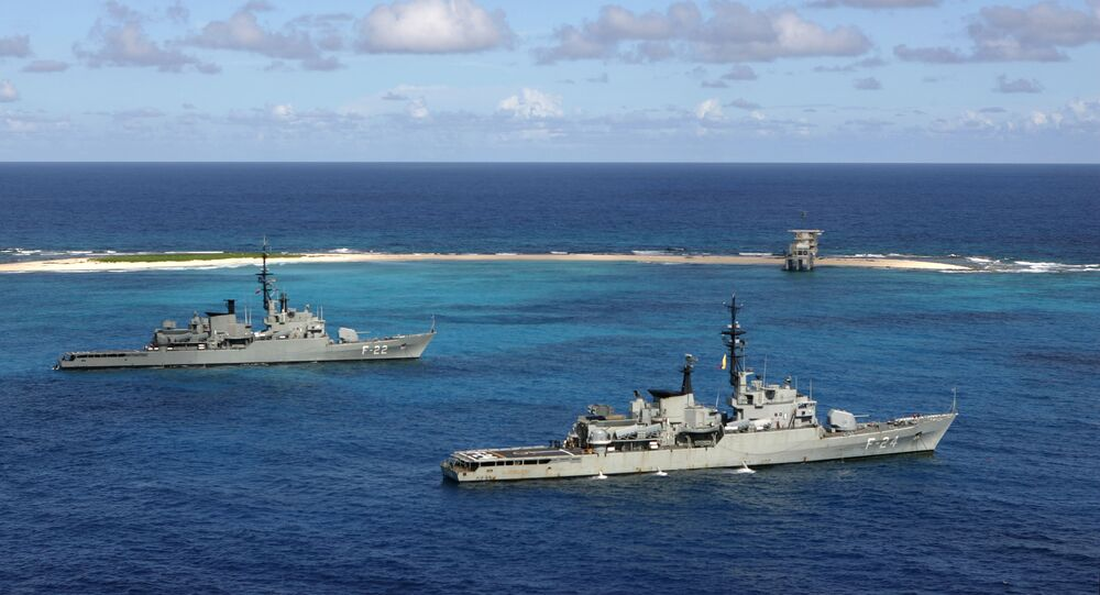 Venezuelan Navy war ships General Soublette, right, and Admirante Brion, left, anchor off Isla de Aves
