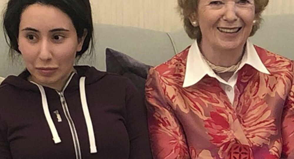 In this Saturday, Dec. 15, 2018 photo, released on Monday, Dec. 24, 2018, by the United Arab Emirates' Ministry of Foreign Affairs and International Cooperation, Sheikha Latifa bint Mohammed Al Maktoum, a daughter of Dubai's ruler Sheikh Mohammed bin Rashid Al Maktoum, left, meets Mary Robinson, a former United Nations High Commissioner for Human Rights and former president of Ireland, in Dubai, United Arab Emirates