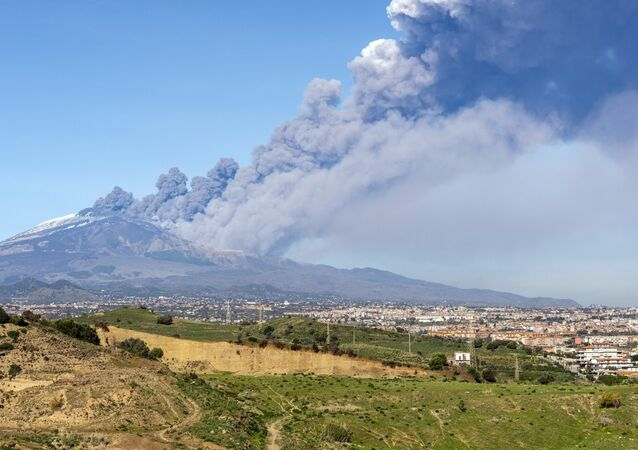 A smoke column comes out of the Etna volcano in Catania, Italy, Monday, Dec. 24, 2018